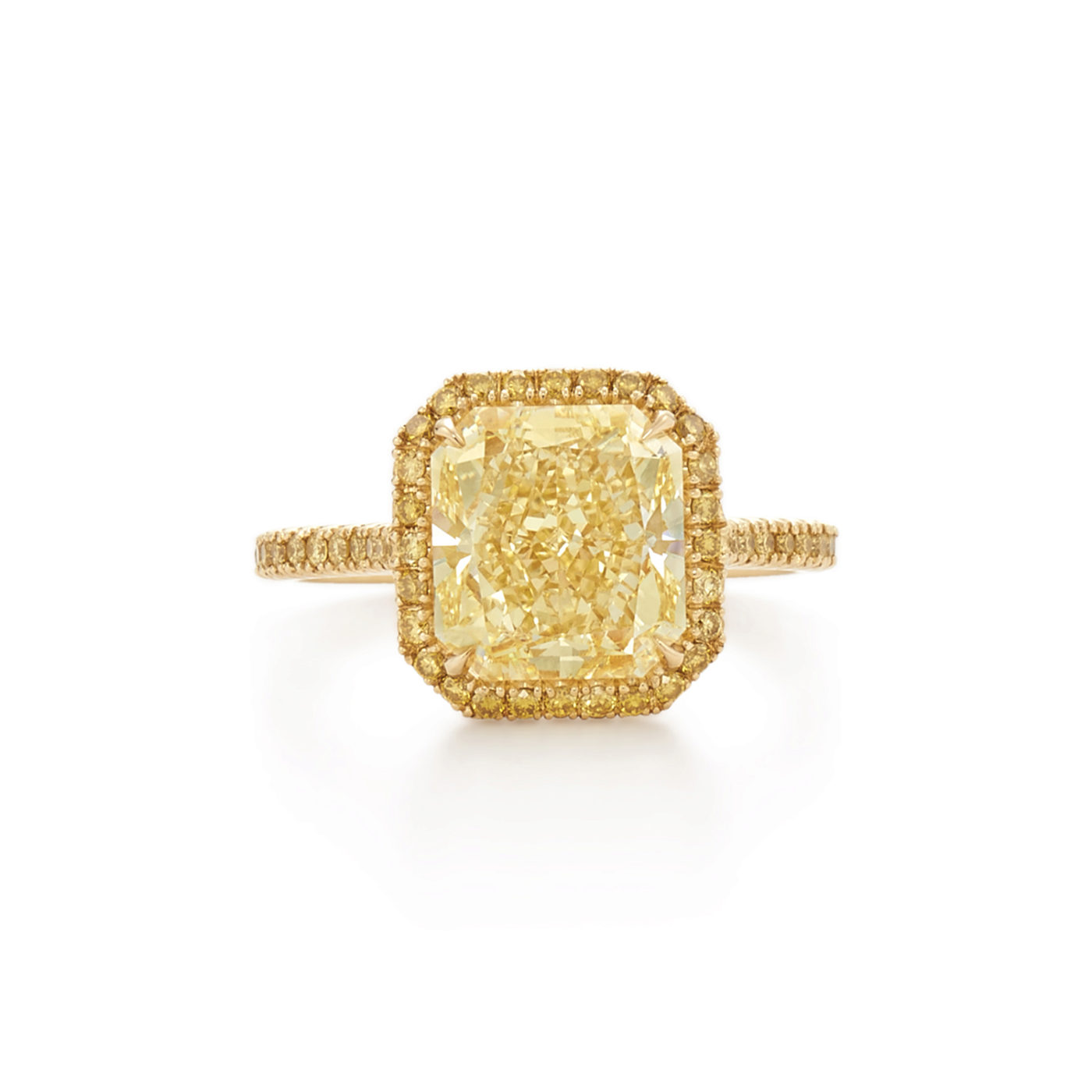 The Kwiat Setting Yellow Radiant Cut Diamond Engagement Ring With A Thin Pave Diamond Halo In