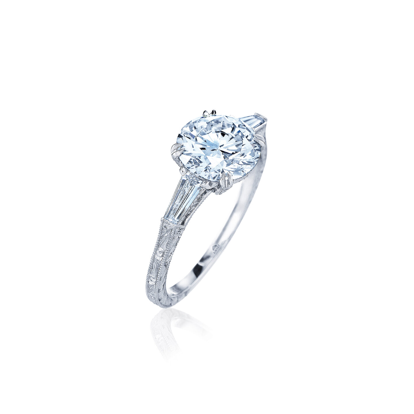 Round Brilliant Diamond Engagement Ring With Two Tapered Baguette Side Stones In A Vintage Style In