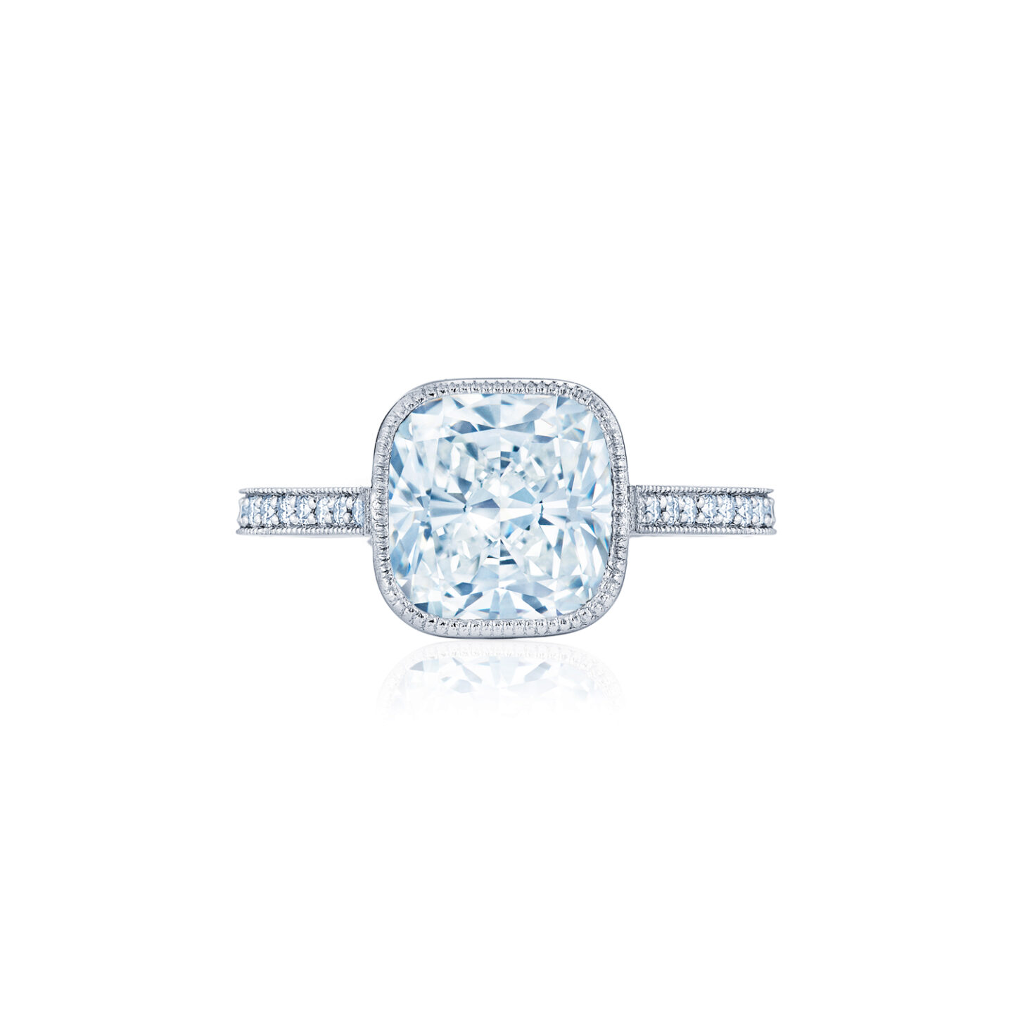 Cushion Cut Diamond Engagement Ring In A Bezel Setting With A Milgrain Edge In Platinum